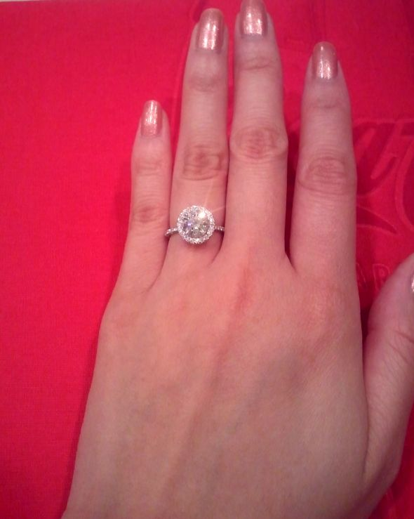 halo-engagement-ring-on-finger