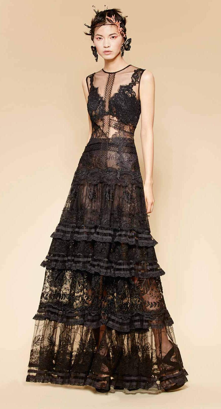 Long couture black gown made of fine French lace with boho folk lace layered